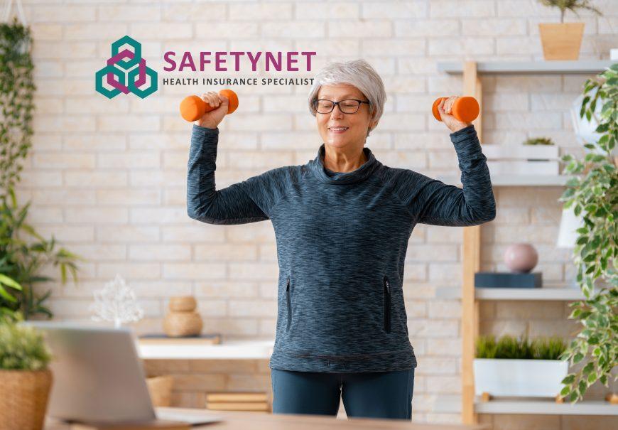 Senior Woman Exercising At Home Jmdnxf5